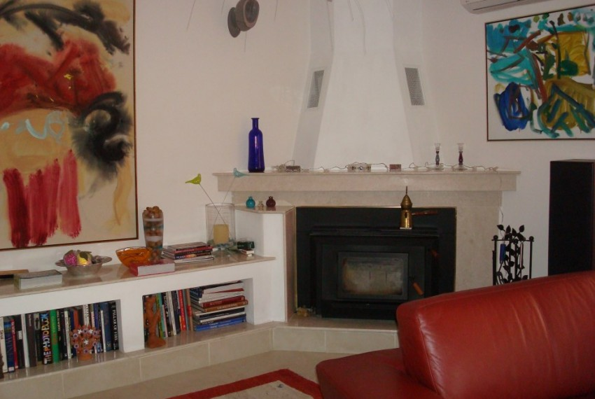nnliving room with catalytic fireplace